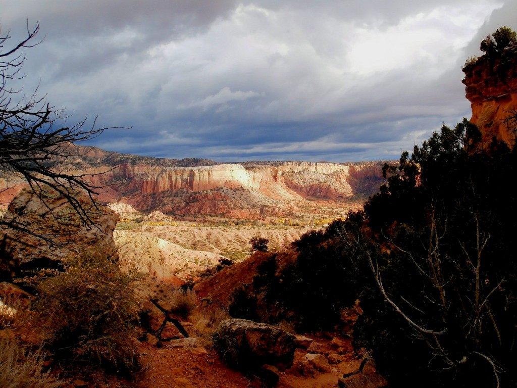 Descending the trail to Ghost Ranch as the storm clouds move in.